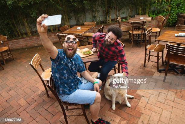 three best friends making a photo with smartphone camera - best sunglasses for bald men stock pictures, royalty-free photos & images
