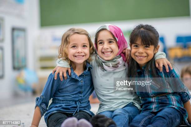 three best friends - multiracial group stock pictures, royalty-free photos & images