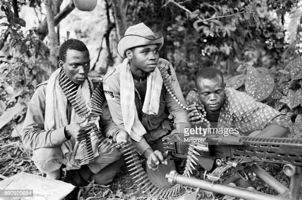 Three Biafran soldiers seen here operating a heavy machine gun during the Biafran conlict 11th June 1968