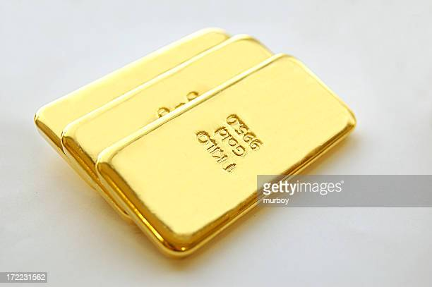 Three big gold bars with a white background
