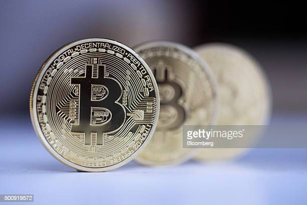 Three Bitcoins stand in this arranged photograph in Danbury UK on Thursday Dec 10 2015 Bitcoin the digital currency climbed on Wednesday to hit its...
