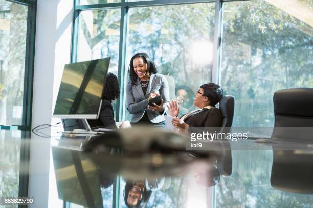 three black women in business meeting - minority groups stock pictures, royalty-free photos & images