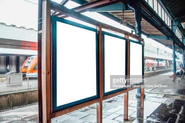 three blank billboards at railroad station - drie dingen stockfoto's en -beelden