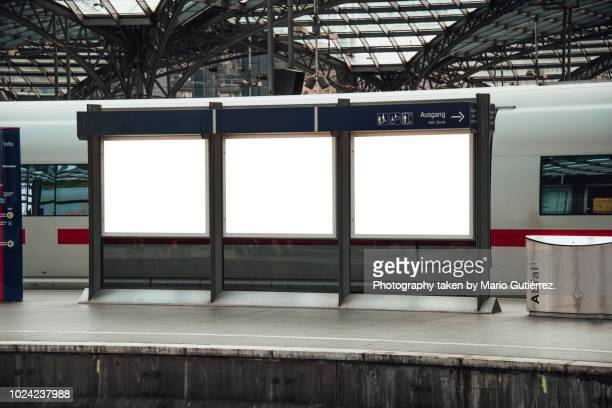 three blank billboards at railroad station - three objects stock pictures, royalty-free photos & images