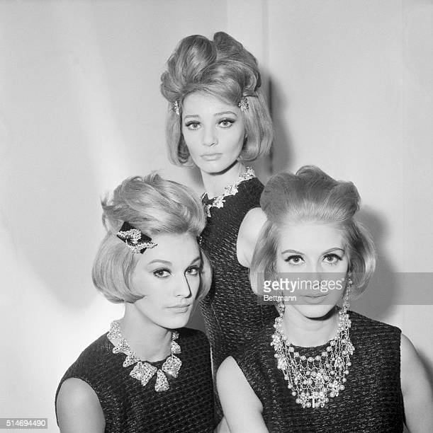Three blonde women model new hairstyles designed by hairstylist Guillaume of Paris for the Spring of 1964 Paris France