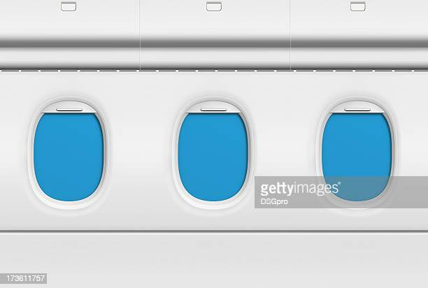 Three blue covered airplane portholes