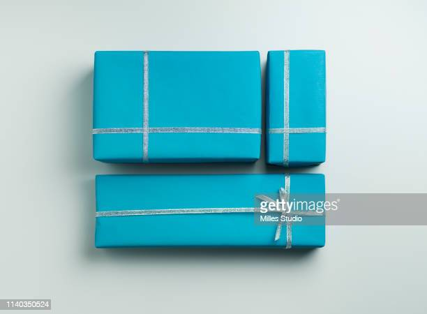 three blue gift wrapped gifts with silver ribbon - 包装紙 ストックフォトと画像