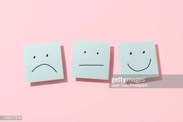 three blue sticky blank notes on pink background - emotion stock pictures, royalty-free photos & images