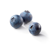 Three blueberries on a white background