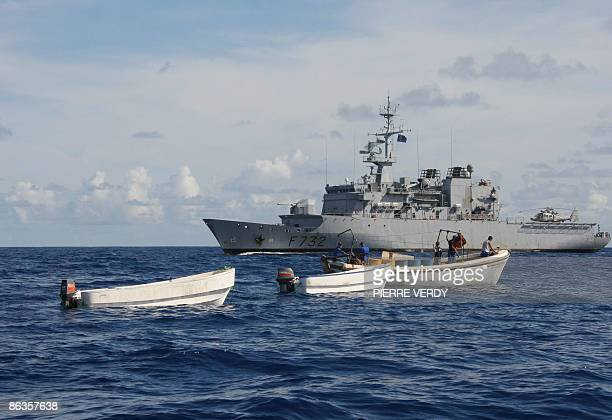 Three boats seized from suspected Somali pirates are cleaned in the sea off the French warship Le Nivose on May 3 2009 Somali pirates said on May 3...