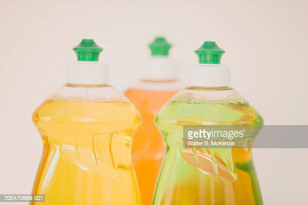 Three bottles of dish washing liquid