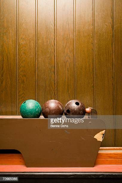 Three bowling balls in bowling alley