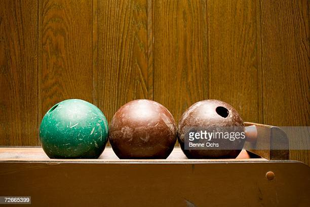 Three bowling balls