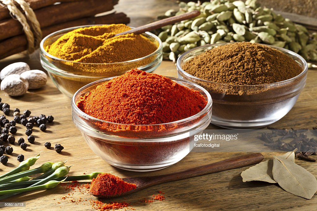 Three bowls filled with spices on rustic wood table : Stock Photo