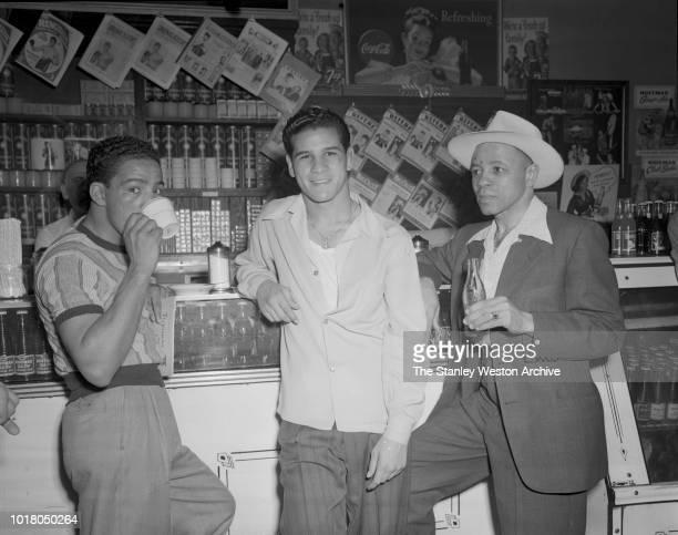 Three boxers enjoy refreshments after training in Stillman's Gym circa 1955 in New York City New York