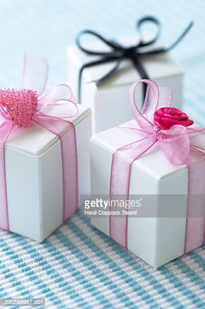 three boxes of chocolates with pink and black ribbon, close-up - heidi coppock beard fotografías e imágenes de stock