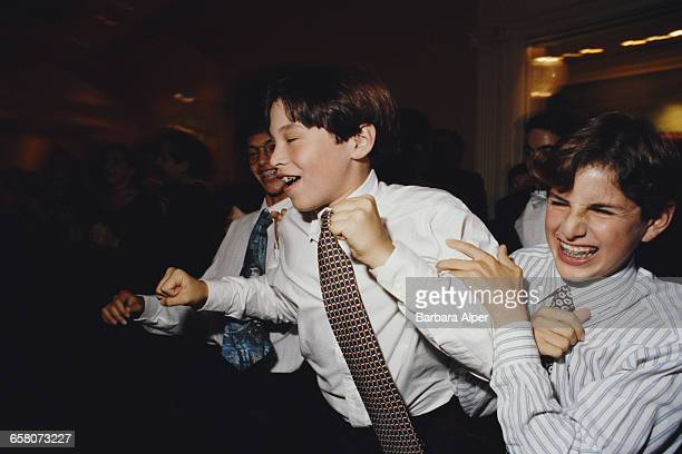 Three boys at a Bar Mitzvah in Southfield Michigan September 1986