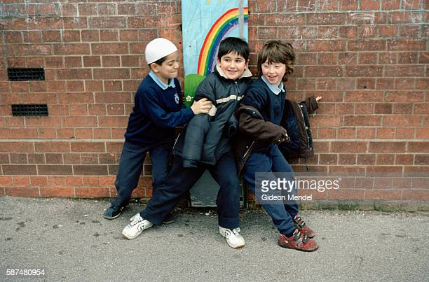 Three boys at Millfields Community School play a boisterous game during break time This is a large innercity primary school with 604 children on its...