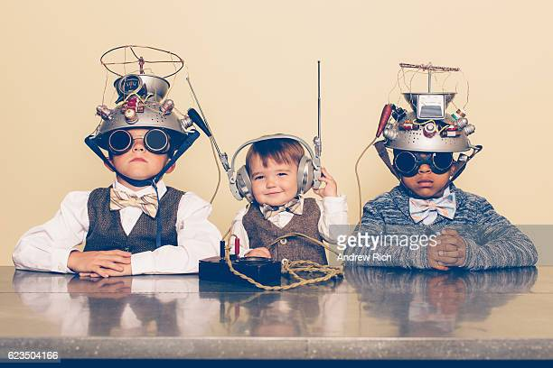 three boys dressed as nerds with mind reading helmets - innovation stock-fotos und bilder