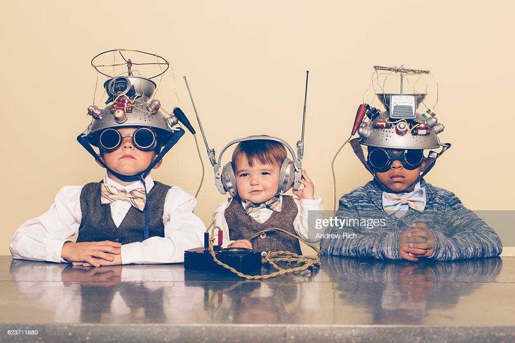 Three Boys Dressed as Nerds with Mind Reading Helmets : Stockfoto