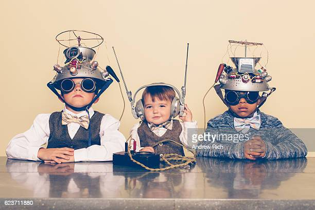 three boys dressed as nerds with mind reading helmets - innovation stock pictures, royalty-free photos & images