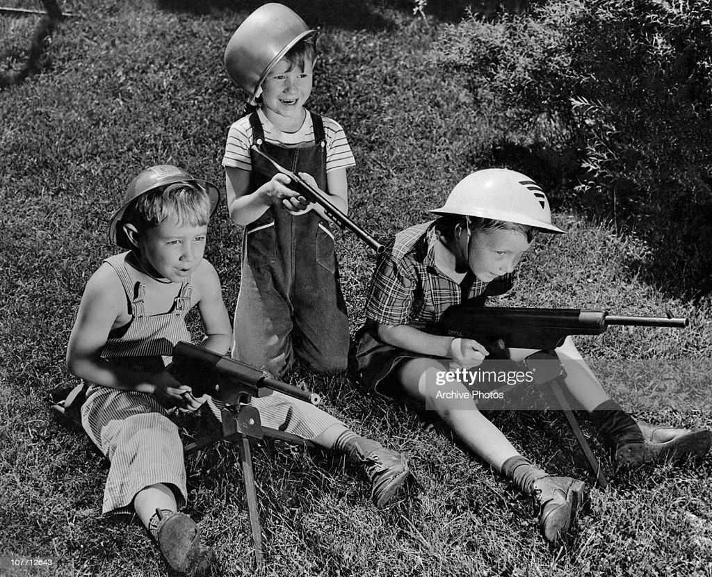 Playing With Toy Guns : News Photo