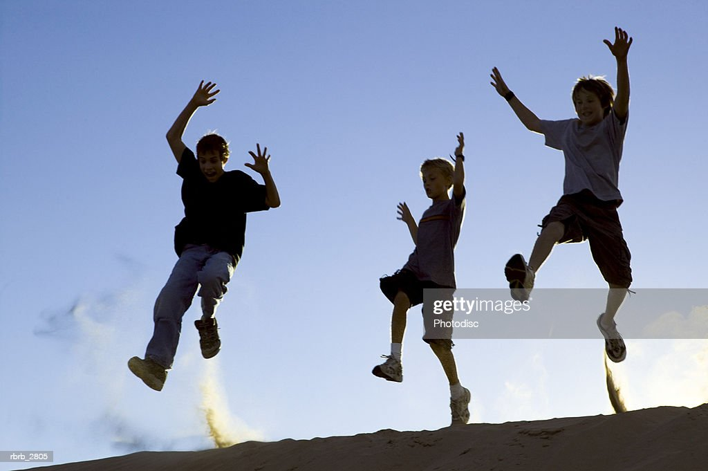 Three boys jumping : Foto de stock