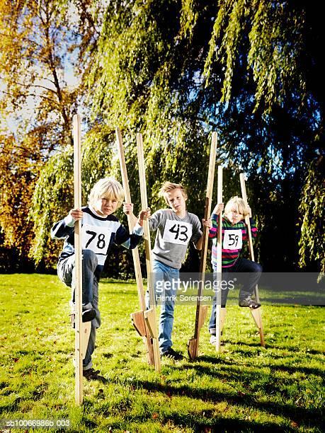 Three boys (8-11) on stilts