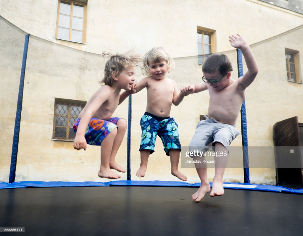 Three boys on trampoline : Stock Photo