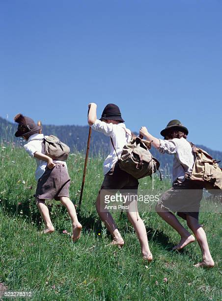 Three Boys Walking Uphill