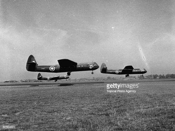Three British Airspeed Horsa gliders taking to the air towed by Whitleys These gliders were used as troop carriers in the Allied invasion of Europe...
