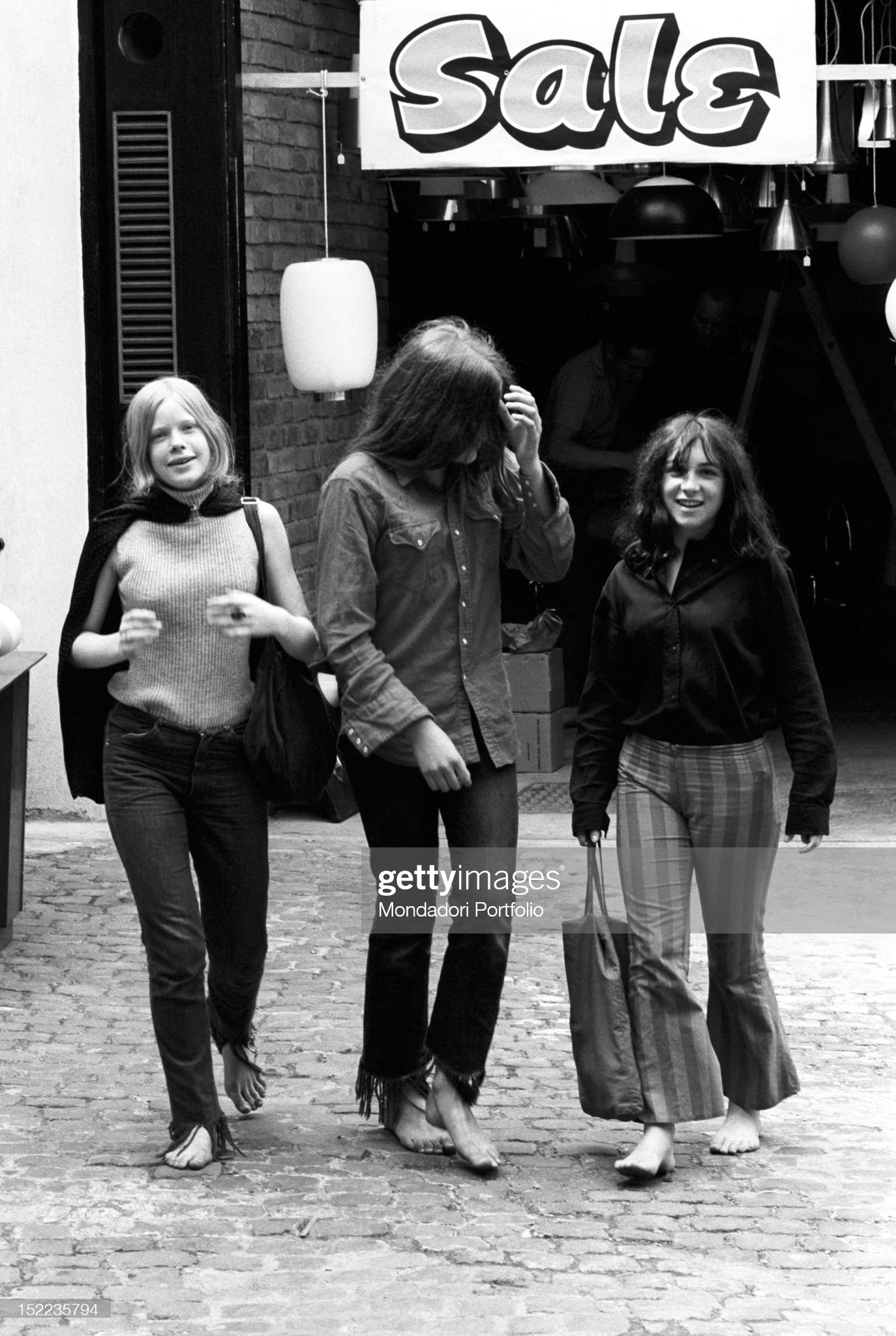 https://media.gettyimages.com/photos/three-british-girls-walking-barefoot-in-the-streets-of-the-city-they-picture-id152235794?s=2048x2048