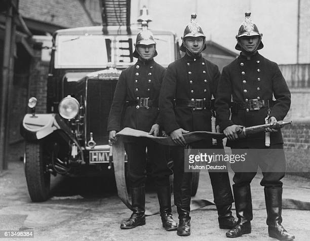 Three brothers James Sidney and Robert Hall who are all members of the Acton Town Fire Brigade in west London 2nd November 1938 Their father also...