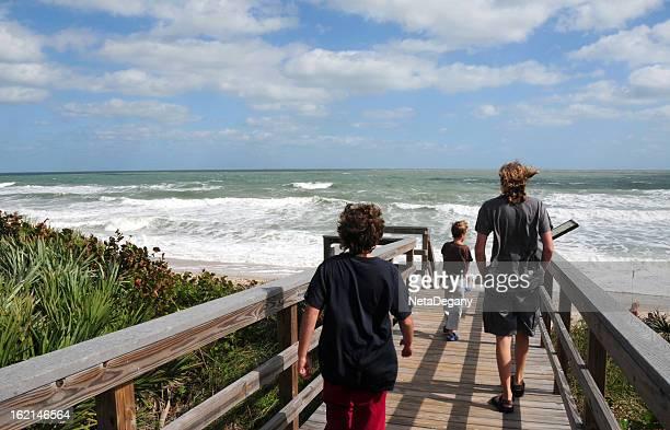 Three brothers walking towards the ocean, Cape Canaveral  National Seashore