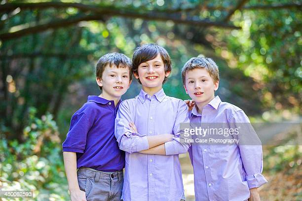 three brothers-twins pose with their older brother - サンブルーノ ストックフォトと画像