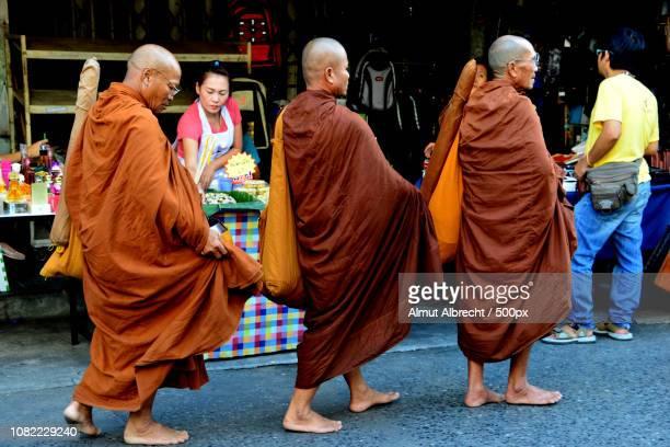 three buddhist monks in Bangkok
