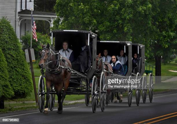 Three buggies carrying Amish girls heading home from church use the main highway in Jamestown to get to their farm nearby A Washington PostKaiser...
