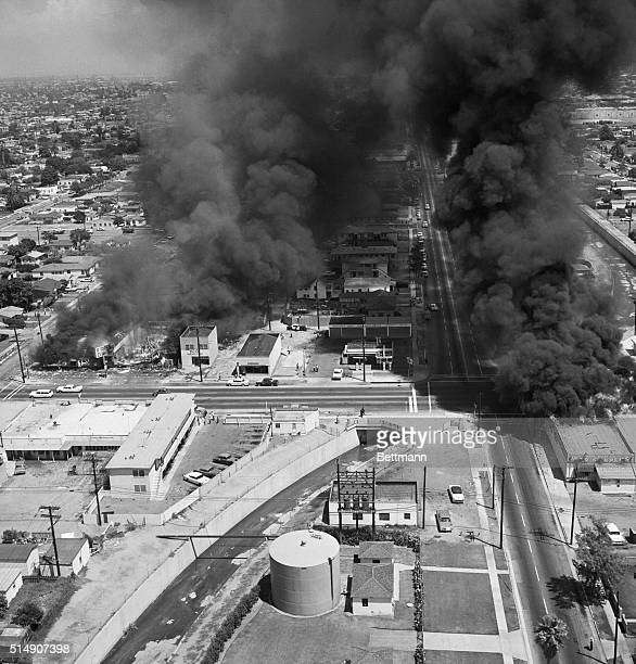Three buildings burn on Avalon Blvd during the third day of rioting in the Watts section of Los Angeles