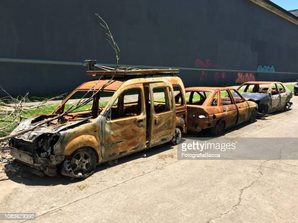three burnt cars in the street - car crash wall stock photos and pictures