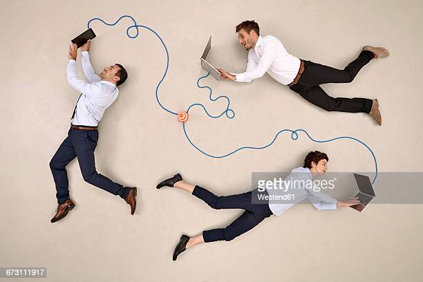 three business colleagues being connected via devices - beige background stock pictures, royalty-free photos & images