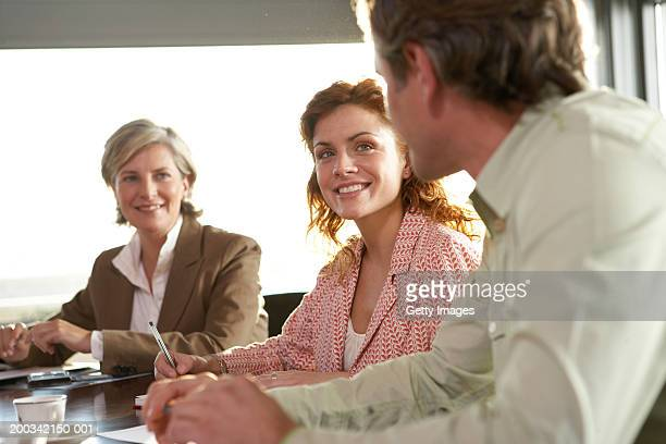 Three business colleagues in  meeting, smiling