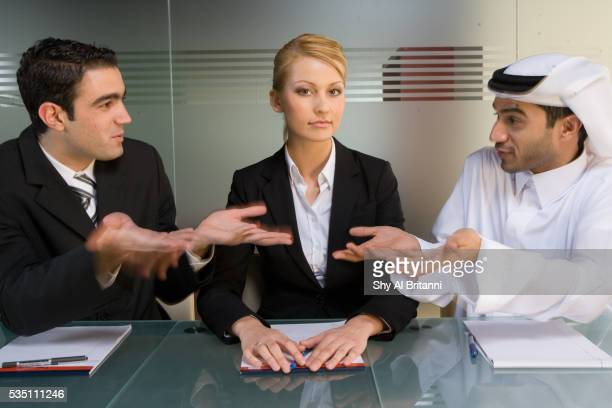 three business colleagues meeting in a conference room. - collar stock pictures, royalty-free photos & images