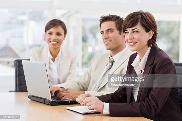 Three business colleagues sitting together