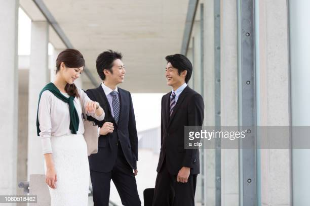 three business men and women - nur japaner stock-fotos und bilder