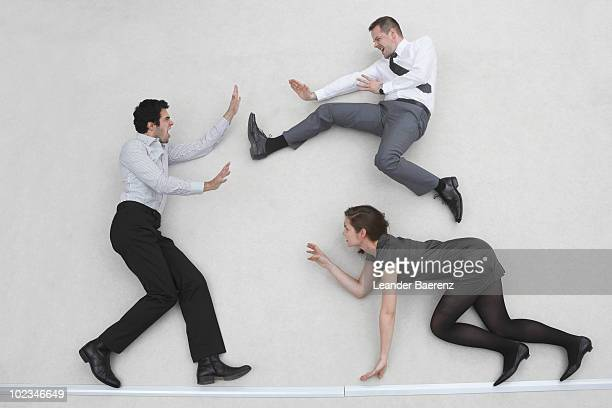 three business people fighting, elevated view - fighting stance stock pictures, royalty-free photos & images