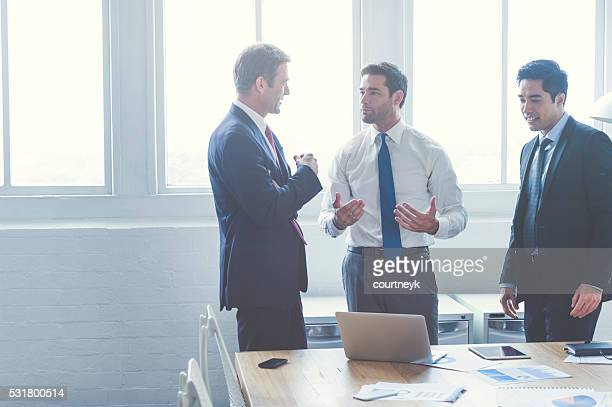 Three business people having a discussion.