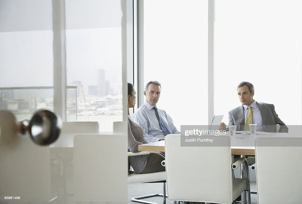 Three business people in a meeting  : Stock-Foto