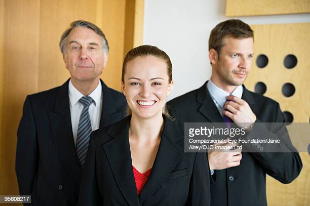 three business people in suits