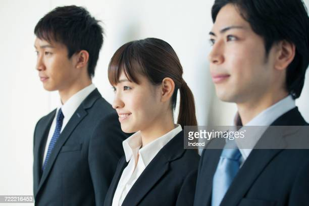 Three business people looking away