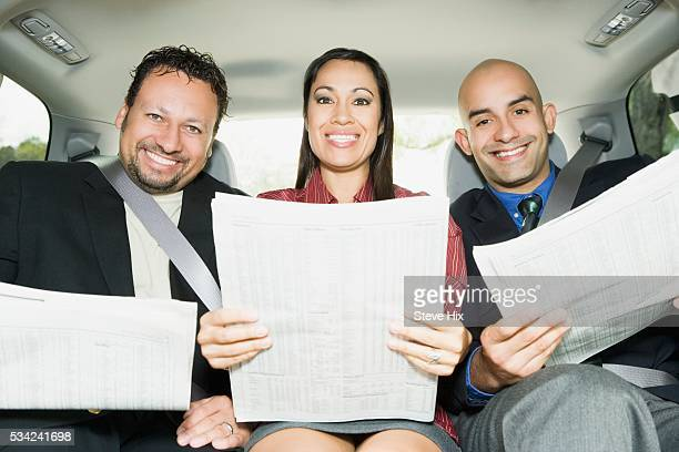Three Business People Reading Newspapers